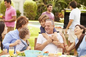 family enjoying meal in garden together